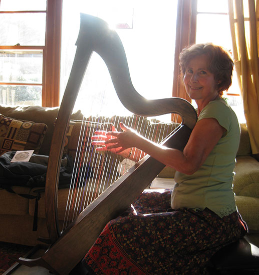 Victoria Lee, at home with her harp